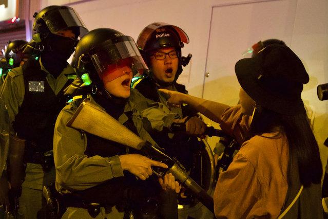 A resident confronts riot police outside of the Prince Edward metro station in Hong Kong, Saturday, November 30, 2019. (Photo by Ng Han Guan/AP Photo)