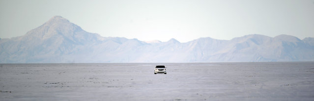 In this Monday, July 20, 2015 photo, a car drives across the Bonneville Salt Flats in Utah. (Photo by Rick Bowmer/AP Photo)