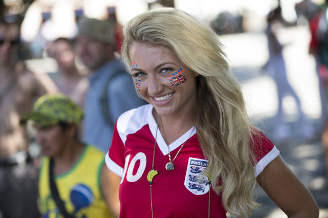 England fan Sarah Jayne Hart relaxes in Praca Sao Sebastiao, in front of the Teatro Amazonas opera house, ahead of England's opening game in the FIFA World Cup on June 14, 2014 in Manaus, Brazil. Group D teams, England and Italy, will play their opening match of the 2014 FIFA World Cup when they meet in Manaus this evening. (Photo by Oli Scarff/Getty Images)