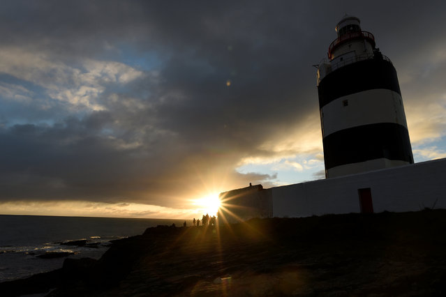 The 800-year-old Hook Head lighthouse is seen on New Year's day after the Claiming of the Waters ceremony in Hook Head, Ireland January 1, 2017. (Photo by Clodagh Kilcoyne/Reuters)