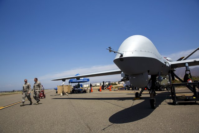 """A General Atomics MQ-9 Reaper stands on the runway during """"Black Dart"""", a live-fly, live fire demonstration of 55 unmanned aerial vehicles, or drones, at Naval Base Ventura County Sea Range, Point Mugu, near Oxnard, California July 31, 2015. (Photo by Patrick T. Fallon/Reuters)"""