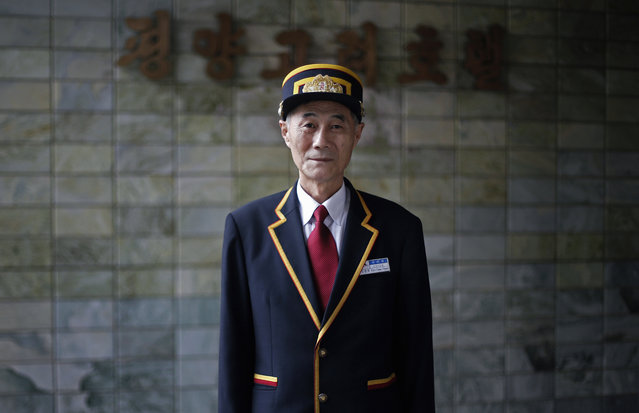In this October 23, 2014, photo, Kim Guan Huan, 60, a concierge, poses for a portrait at the entrance of the Koryo Hotel in Pyongyang, North Korea. Kim has been working at the hotel for the past 30 years. (Photo by Wong Maye-E/AP Photo)