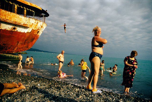 "Sukhum, Abkhazia, Georgia, 2005. Sea bathers. Jonas Bendiksen writes: ""When people are hurling themselves from old shipwrecks I don't necessarily think, 'Oh, here is a decisive moment'. Actually, I often don't think so much at all when I photograph, it is more gut instinct working, just lots of reactions"". (Photo by Jonas Bendiksen/Magnum Photos)"