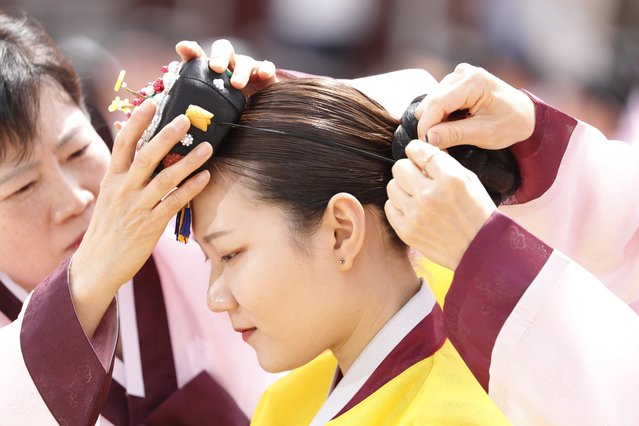 A twenty-year-old South Korean wearing traditional costumes participates in the 45th Coming of Age Day ceremony at Namsangol Hanok Village in Seoul, South Korea, 15 May 2017. (Photo by Jeon Heon-Kyun/EPA)