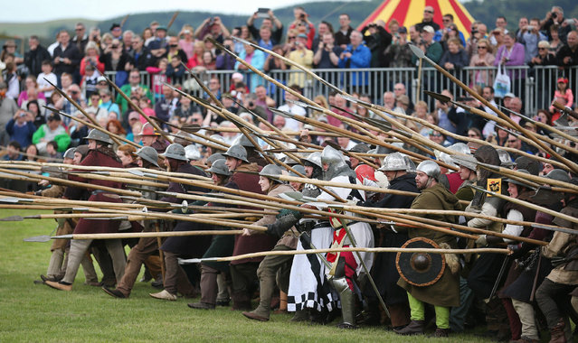 Crowds watch as the Battle of Bannockburn is re-enacted on June 28, 2014 in Stirling, Scotland. The 700th anniversary of the historic battle that saw the outnumbered Scots conquer the English led by Edward II in the First War of Scottish Independence. (Photo by Peter Macdiarmid/Getty Images)