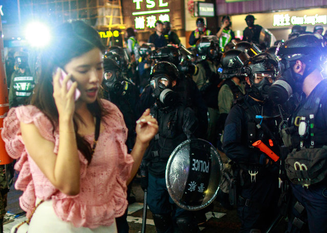 Riot police take to the streets in large numbers to suppress anti-government protesters in Hong Kong on August 31, 2019. Train service to Hong Kong's airport was suspended Sunday as pro-democracy demonstrators gathered there, while protesters outside the British Consulate called on London to grant citizenship to people born in the former colony before its return to China. (Photo by Kevin On Man Lee/Penta Press/Rex Features/Shutterstock)