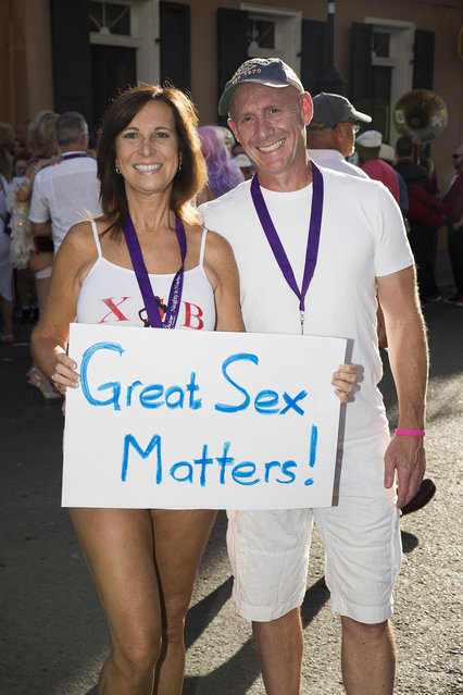 A swinging couple at the Naughty in N'awlins Sexual Freedom Parada held in New Orleans, Louisiana, Wednesday July 5th, 2017. (Photo by Mathew Growcoot/News Dog Media)