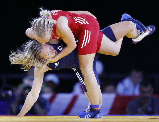 Scotland's Jayne Clason (red) and Scotland's Shannon Hawke during the WFS 53 kg quarter-finals Wrestling at the SECC during the 2014 Commonwealth Games in Glasgow, on July 30, 2014. (Photo by Danny Lawson/PA Wire)