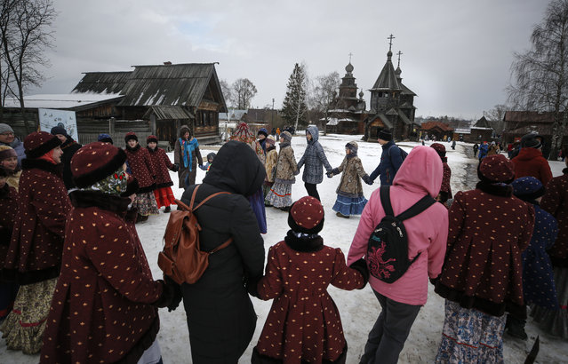 Artists and guests perform a traditional round dance at the Maslenitsa celebrations in the town of Suzdal (200km from Moscow), Russia, 29 February 2020. (Photo by Sergei Ilnitsky/EPA/EFE)
