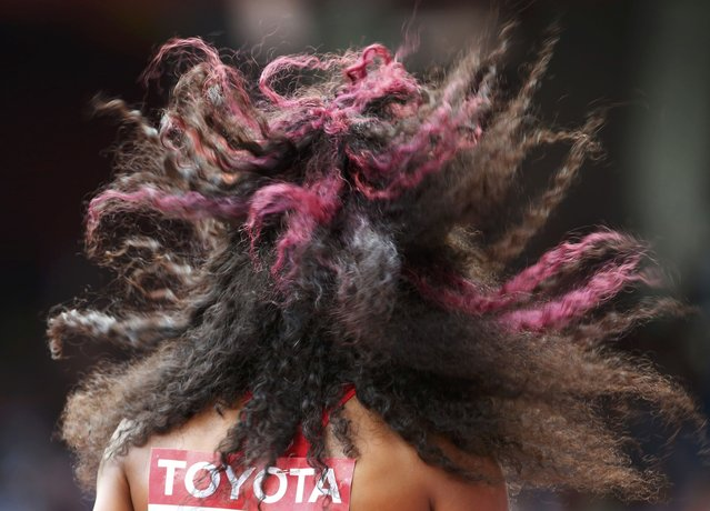 The hair of Natasha Hastings of U.S. is blown by the wind before the women's 400 metres heats during the 15th IAAF World Championships at the National Stadium in Beijing, China August 24, 2015. (Photo by Lucy Nicholson/Reuters)