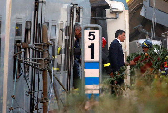 Italian Prime Minister Matteo Renzi walks at the site where two passenger trains collided in the middle of an olive grove in the southern village of Corato, near Bari, Italy, July 12, 2016. (Photo by Alessandro Garofalo/Reuters)