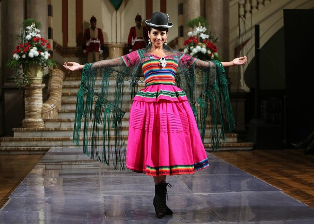 "A model presents a design by Bolivian designer Eliana Paco Paredes at the Government Palace of Bolivia, also known as Palacio Quemado in La Paz, Bolivia, 15 July 2016. Eliana Paco Paredes presented her new collection of clothes for indigenous women known as ""cholitas"". The collection is called ""Pachamama"" (Mother Earth) and is planned to be presented at the New York Fashion Week in September 2016. (Photo by Martin Alipaz/EPA)"
