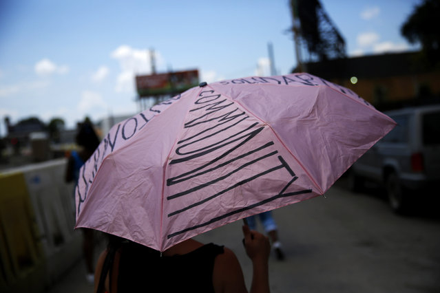 A woman marks the tenth anniversary of Hurricane Katrina by taking part in a remembrance and second-line parade down St. Claude Avenue in New Orleans, Louisiana August 29, 2015. (Photo by Edmund D. Fountain/Reuters)