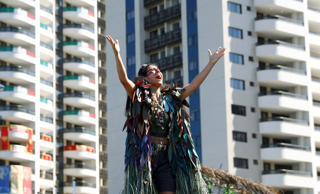 A dancer performs during the welcoming ceremony at the Olympic Village in Rio de Janeiro, Brazil August 1, 2016. (Photo by Kai Pfaffenbach/Reuters)