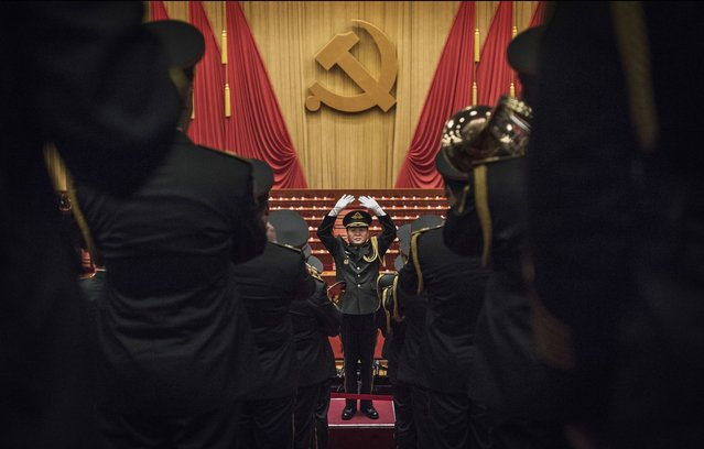 """A Chinese military band plays after the speech of Chinese President Xi Jinping, at the opening session of the 19th Communist Party Congress held at The Great Hall Of The People on October 18, 2017 in Beijing, China. The Communist Party Congress happens only twice in a decade, and provides a glimpse into the world of Chinese politics. For Xi Jinping, the week-long event is a confirmation of his power as Party leader and China's president. Xi's speech to the 2300 delegates in the Great Hall of the People was both optimistic and cautionary, and vowed that Chinese socialism was entering a """"new era"""". Xi's control of the Party and the country is almost irrefutable, as he consolidated power during his first five year term and is believed to have widespread popularity. (Photo by Kevin Frayer/Getty Images)"""