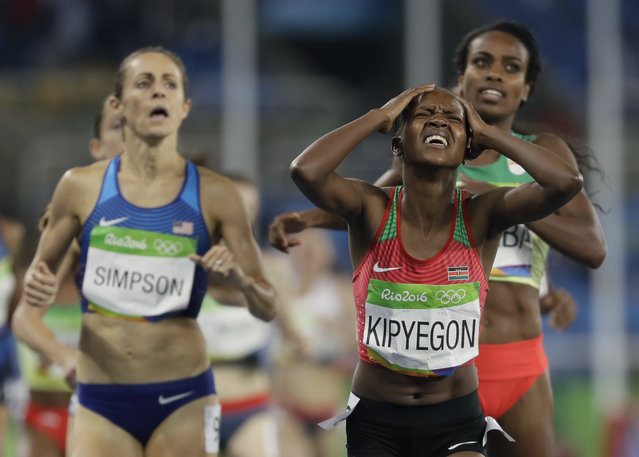 Kenya's Faith Chepngetich Kipyegon crosses the line to win the gold medal in the women's 1500-meter final during the athletics competitions of the 2016 Summer Olympics at the Olympic stadium in Rio de Janeiro, Brazil, Tuesday, August 16, 2016. (Photo by David J. Phillip/AP Photo)