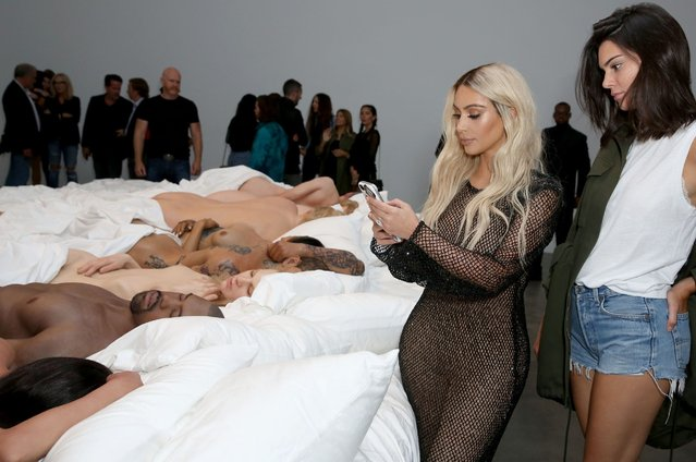 Kim Kardashian and Kendall Jenner attend Famous by Kanye West a private exhibition event at Blum And Poe, Los Angelesat Blum & Poe on August 26, 2016 in Los Angeles, California. (Photo by Rachel Murray/Getty Images for Kanye West)