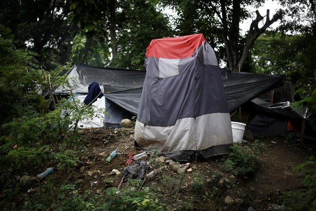 A makeshift bathroom is seen at a camp at the border between Costa Rica and Nicaragua, in Penas Blancas, Costa Rica, September 8, 2016. (Photo by Juan Carlos Ulate/Reuters)