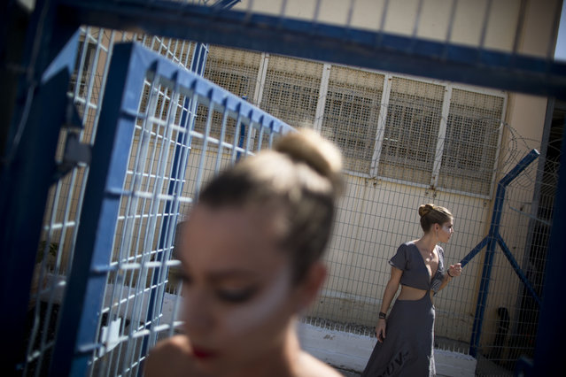 In this Monday, October 27, 2014 photo, models wait to walk a runway before a show in Neve Tirza prison in Ramle, central Israel. (Photo by Oded Balilty/AP Photo)