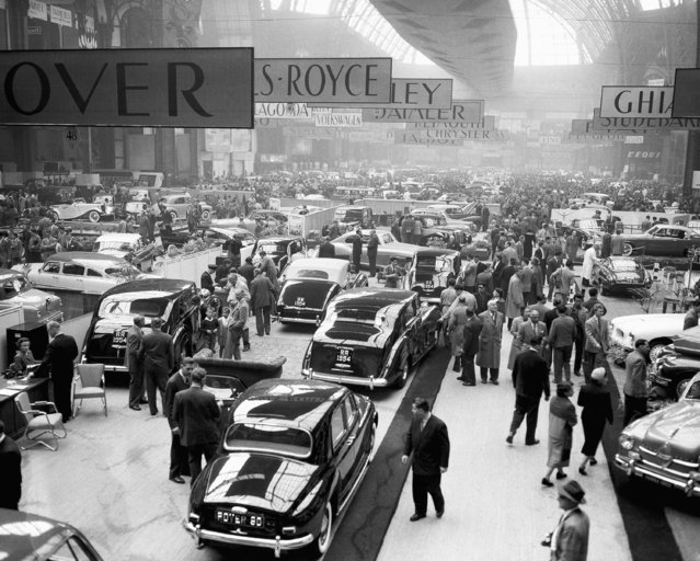 This is a general view of the Grand Palais exhibition Hall in Paris, France on October 1, 1953, and was made at the opening of the 40th Paris Motor Show. This auto show is one of the largest in the world with a total of some 1,300 exhibitors, including 20 car manufacturers. Car makers from France, Great Britain, Germany, Italy, Czechoslovakia, Spain, The Netherlands and United States, are among the exhibitors. (Photo by AP Photo)
