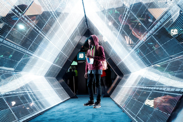 Jordan Jtakin walks though a 5G wireless broadband technology display in the Intel booth during the 2018 CES in Las Vegas, Nevada, U.S. January 10, 2018. (Photo by Steve Marcus/Reuters)