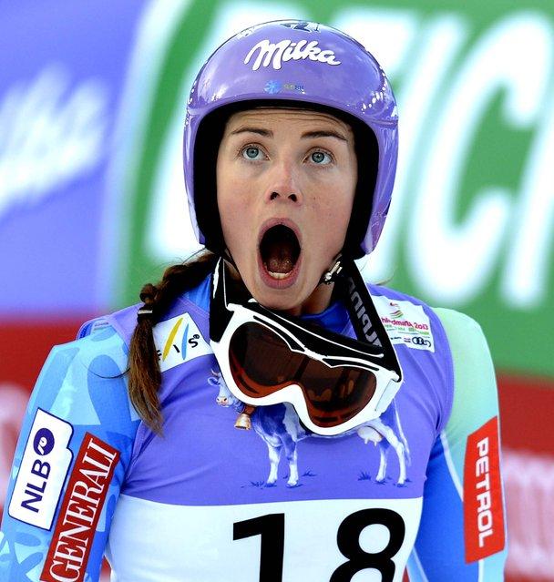 Slovenia's Tina Maze reacts as she sees Vonn crashing during the women's super-G on February 5, 2013. (Photo by Kerstin Joensson/Associated Press)
