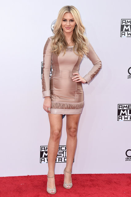 Morgan Stewart arrives at the 42nd annual American Music Awards at Nokia Theatre L.A. Live on Sunday, November 23, 2014, in Los Angeles. (Photo by John Shearer/Invision/AP Photo)