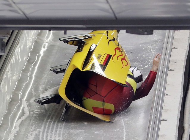 Driver Nico Walther and Christian Poser of Germany crash in the finish area after the second run during the two-man bobsled competition at the 2018 Winter Olympics in Pyeongchang, South Korea, Sunday, Februaary 18, 2018. (Photo by Michael Sohn/AP Photo)