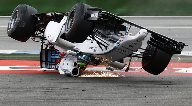 Williams Formula One driver Felipe Massa of Brazil crashes with his car in the first corner after the start of the German F1 Grand Prix at the Hockenheim racing circuit, in this July 20, 2014 file photo. (Photo by Kai Pfaffenbach/Reuters)