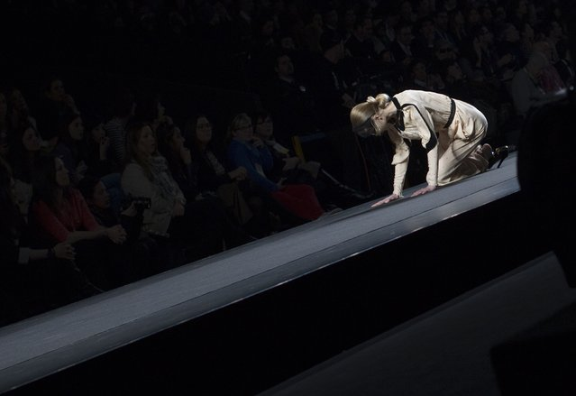 A model falls as she presents a creation from designer Miguel Palacio's Fall/Winter 2012 collection during the Mercedes-Benz Fashion Week in Madrid February 2, 2012. (Photo by Juan Medina/Reuters)