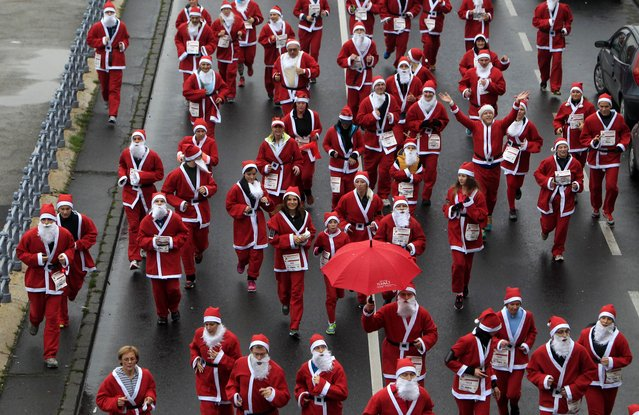 "Runners dressed in Santa Claus costumes take part in the ""Santa Claus Run"" in Budapest, December 6, 2014. Around 3,000 runners took part this year. (Photo by Bernadett Szabo/Reuters)"
