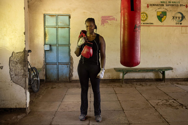 Sarah Achieng a 31 year-old professional boxer and sports administrator poses after her training session at Kariobangi social hall gym in Nairobi, Kenya on February 27, 2018. (Photo by Patricia Esteve/AFP Photo)