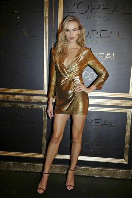 Natasha Poly poses for photographers as she arrives at the L'Oreal party, in Paris, Sunday, October 2, 2016. (Photo by Thibault Camus/AP Photo)