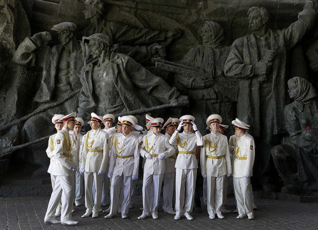 Cadets of the Ukrainian Military academy prepare to celebrate the anniversary of victory over the Nazis at a memorial to World War II veterans in Kiev on Thursday. Ukrainians continue to celebrate the World War II anniversary and Victory Day on May 9 as a national holiday. (Photo by Efrem Lukatsky/Associated Press)