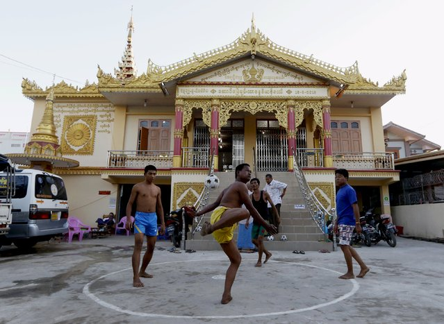 Men play chinlone, a traditional game in Myanmar, in front of a polling station ahead of tomorrow's general election in Mandalay, Myanmar, November 7, 2015. (Photo by Olivia Harris/Reuters)