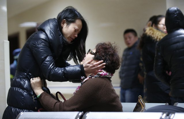 Relatives of a victim hug as they wait at a hospital where injured people of a stampede incident are treated in Shanghai January 1, 2015. At least 35 people were killed and 42 were injured in a stampede during a New Year's celebration on the Bund, a waterfront area in central Shanghai, official Chinese government television CCTV America reported on its website. (Photo by Aly Song/Reuters)