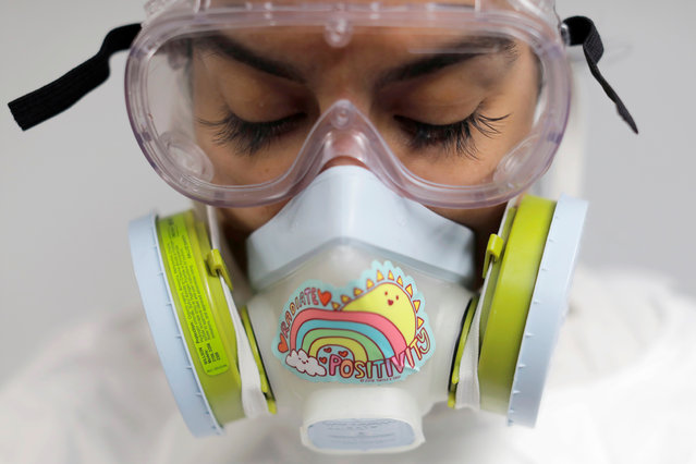 "Alisha Narvaez, 36, the manager at International Funeral & Cremation Services, a funeral home in Harlem, poses for a photo in her personal protective equipment, before embalming a deceased person, during the coronavirus disease (COVID-19) outbreak, in Manhattan, New York City, New York, U.S., April 9, 2020. At the beginning of the pandemic, Narvaez sent her 17-year-old daughter to live with her twin sister, but after two weeks the distance was too much.  ""It's always just been me and her and she wanted to come home"", said Narvaez. ""I gotta make sure I keep healthy just not to harm her"", she added. ""Although she's been in quarantine for several weeks, every day I come home from work is Day Zero for her"". (Photo by Andrew Kelly/Reuters)"