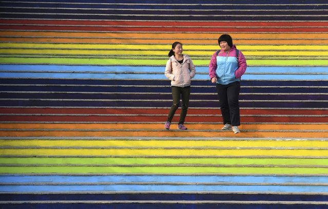 Students walk down a flight of stairs outside a dining hall at the campus of North China University of Water Resources and Electric Power in Zhengzhou, Henan province, January 17, 2015. (Photo by Reuters/Stringer)