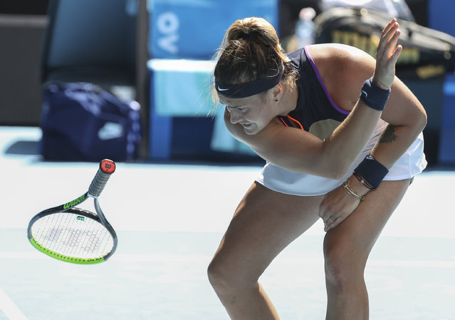 Aryna Sabalenka of Belarus throws her racket in frustration during her fourth round match against United States' Serena Williams at the Australian Open tennis championship in Melbourne, Australia, Sunday, February 14, 2021.(Photo by Hamish Blair/AP Photo)
