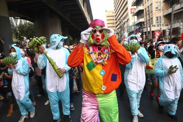 A protester dressed as a clown joins a demonstration against police and government corruption in Bangkok on February 23, 2021. (Photo by Jack Taylor/AFP Photo)