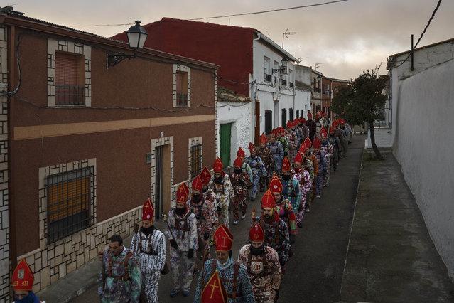 "Members of the Endiablada brotherhood march during the ""Endiablada"" traditional festival in Almonacid Del Marquesado, Spain, Tuesday, February 3, 2015. (Photo by Daniel Ochoa de Olza/AP Photo)"