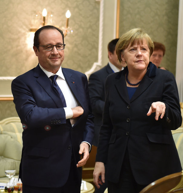 Germany's Chancellor Angela Merkel and France's President Francois Hollande attend a meeting on resolving the Ukrainian crisis in Minsk, February 11, 2015. (Photo by Mykola Lazarenko/Reuters)