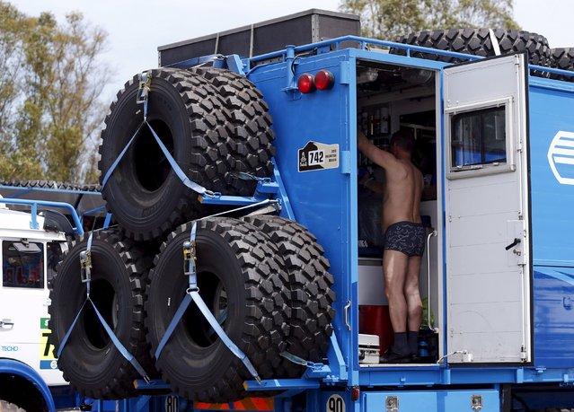 A man works inside an official Dakar Rally truck outside the technical verification area ahead of the Dakar Rally 2016 in Buenos Aires, Argentina, December 31, 2015. (Photo by Marcos Brindicci/Reuters)