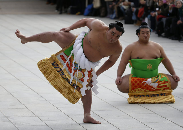 Mongolian-born grand sumo champion Yokozuna Harumafuji (L) performs the New Year's ring-entering rite at the annual celebration for the New Year at Meiji Shrine in Tokyo, Japan, January 7, 2016. (Photo by Yuya Shino/Reuters)