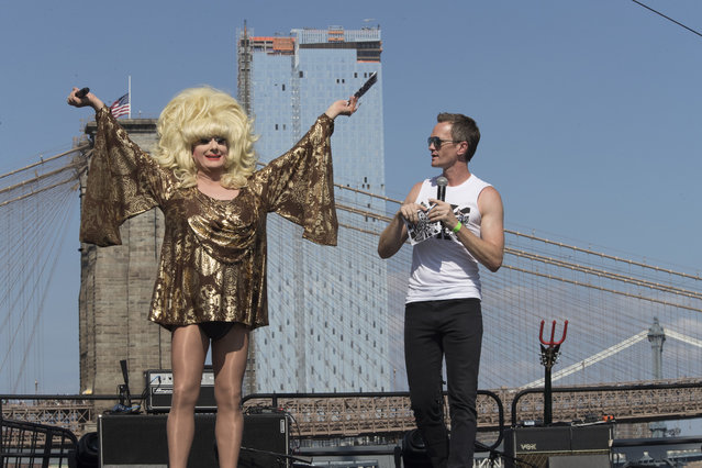 Neil Patrick Harris, right, appears on stage along Lady Bunny during Wigstock, Saturday, September 1, 2018, in New York. The 1980s festival, an impromptu creation of unruly patrons in drag who stumbled out of an East Village club at about 2 a.m. to improvise for homeless people in garbage-strewn, rat-infested Tompkins Square Park, was revived at New York City's Pier 17. (Photo by Mary Altaffer/AP Photo)