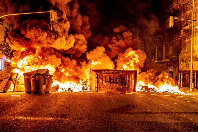 Garbage containers burning at the Aragón street barricade during the demonstration in Barcelona, Spain on February 18, 2021. Third night of protests and riots in response to the arrest and imprisonment of rapper Pablo Hasel accused of exalting terrorism and insulting the crown from the content of the lyrics of his songs. (Photo by Paco Freire/SOPA Images/Rex Features/Shutterstock)