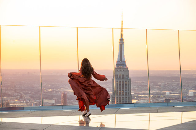 A person watches the sunrise from the Edge observation deck at Hudson Yards on the first day of spring on March 20, 2021 in New York City. (Photo by Noam Galai/Getty Images)