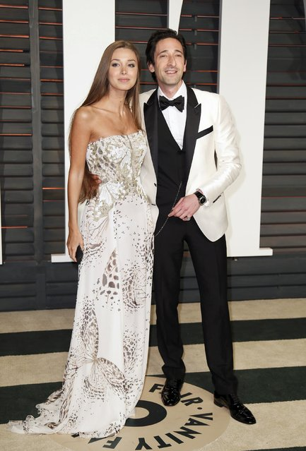 Actor Adrien Brody and Lara Lieto arrive at the 2015 Vanity Fair Oscar Party in Beverly Hills, California February 22, 2015. (Photo by Danny Moloshok/Reuters)
