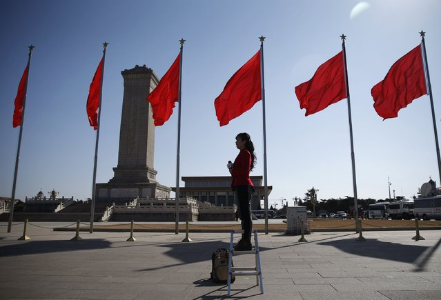 A journalist reports outside the Great Hall of the People ahead of the opening session of Chinese People's Political Consultative Conference (CPPCC) at Tiananmen Square in Beijing, March 3, 2015.  REUTERS/Kim Kyung-Hoon