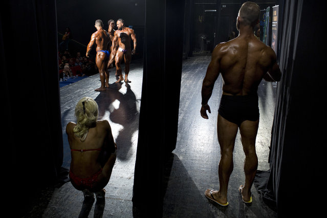 In this Thursday, October 18, 2018 photo, contestants participate in the final round during the National Amateur Body Builders' Association competition in Tel Aviv, Israel. (Photo by Oded Balilty/AP Photo)